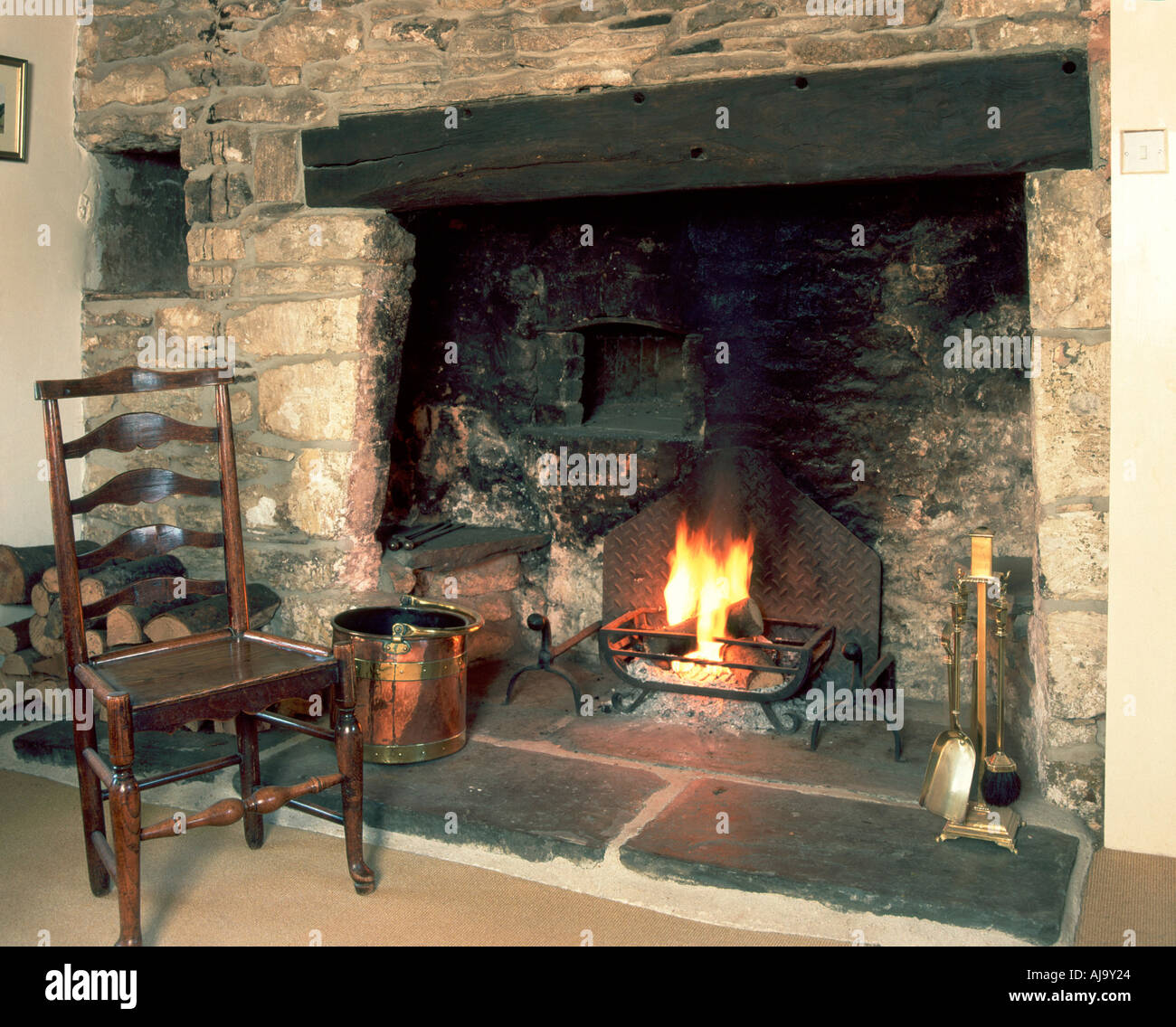 old stone fireplace. Fireside chair by old stone fireplace Stock Photo  Royalty Free