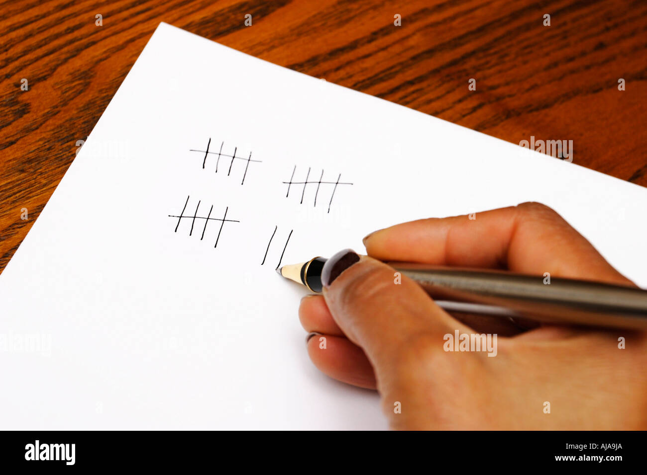 tally marks being written on paper stock photo royalty image stock photo tally marks being written on paper
