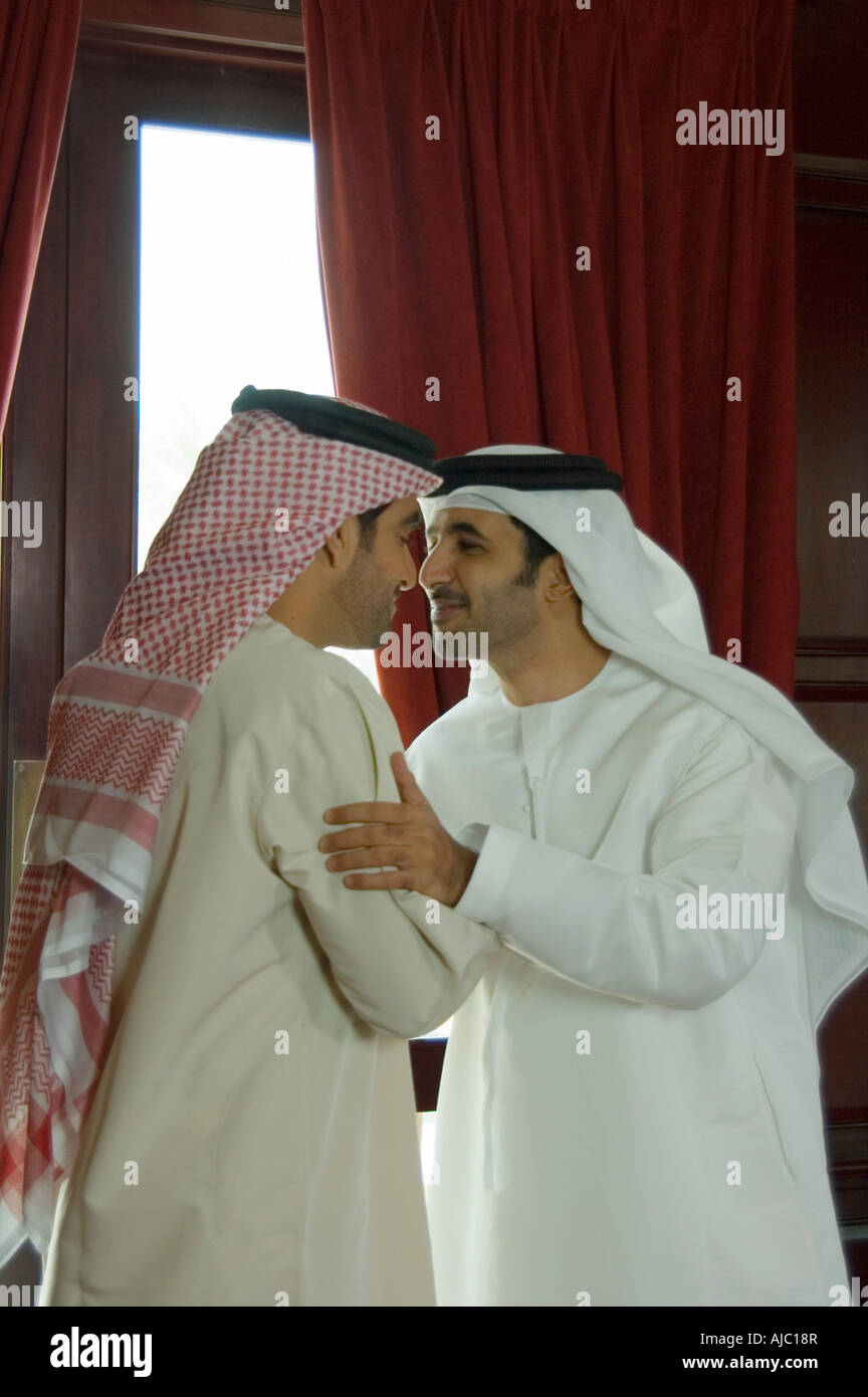 Two arab business men using traditional bedouin greeting stock two arab business men using traditional bedouin greeting kristyandbryce Choice Image