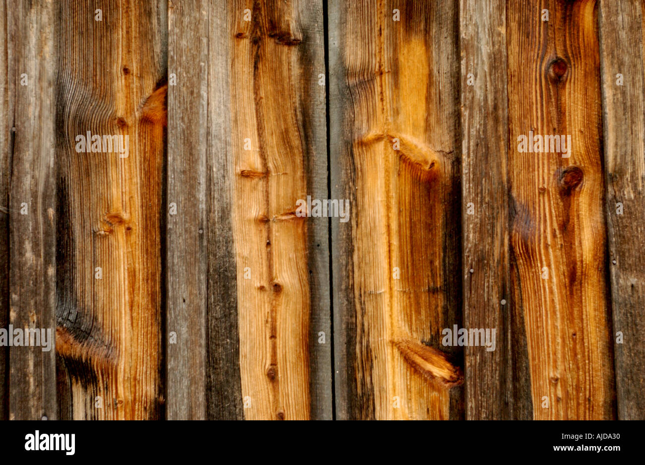 horizontal color image of wood boards on an old barn ...
