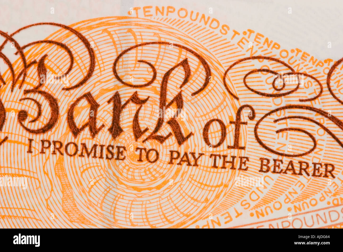 Closeup of British ten pound note I Promise to pay the Bearer – Promise to Pay Note