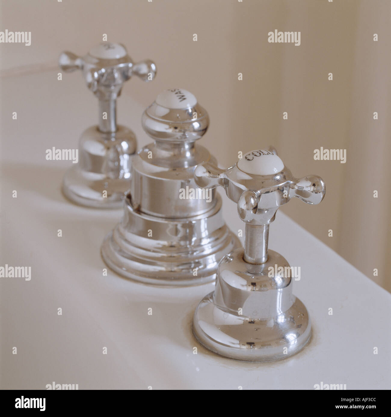 Old fashioned bath taps at Anglesey Abbey Cambridgeshire Stock ...