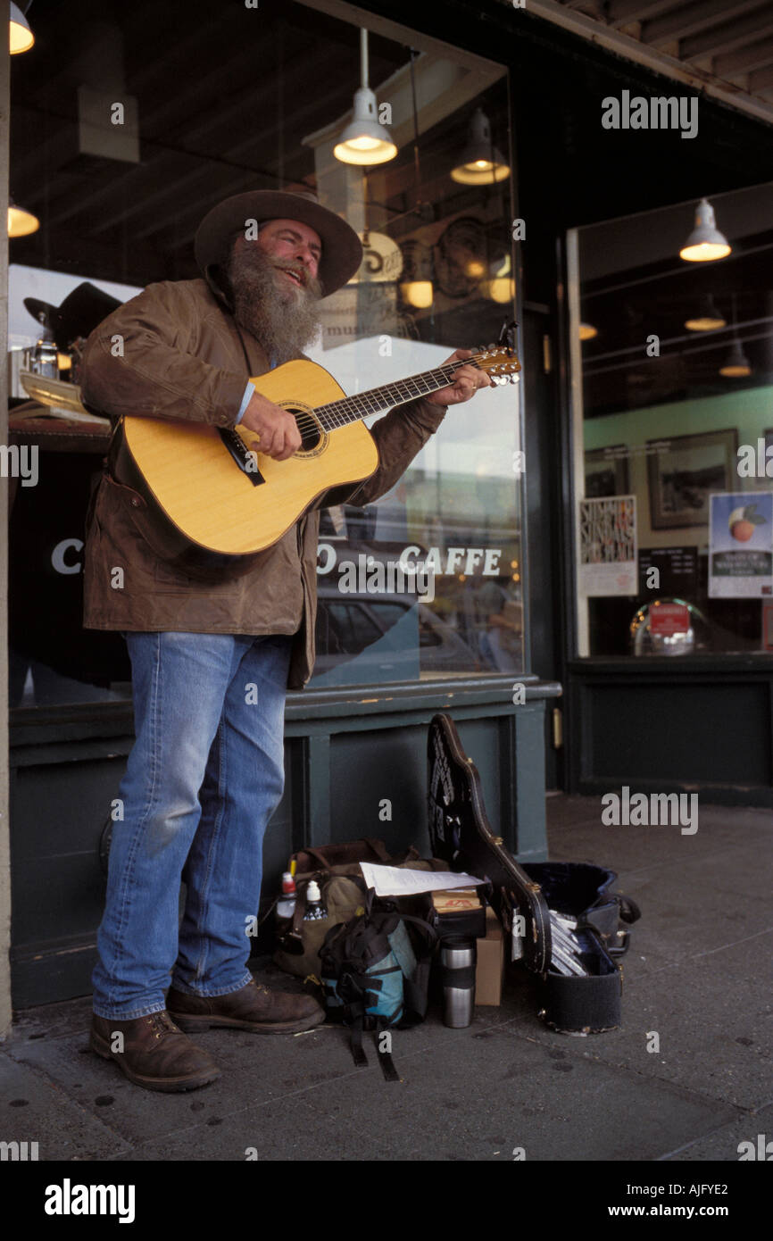 Street Musician With Guitar Performs Outside Original Starbucks Coffee Store At Pike Place Market In Seattle Washington