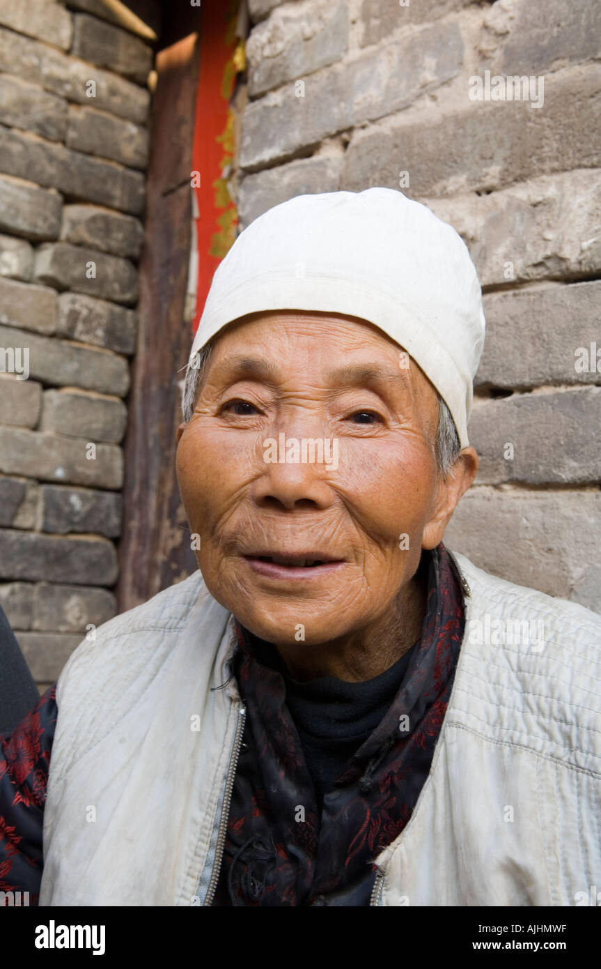 An old lady residing in the ancient town along the Yellow River HuangHe Qikou Shanxi China - an-old-lady-residing-in-the-ancient-town-along-the-yellow-river-huanghe-AJHMWF