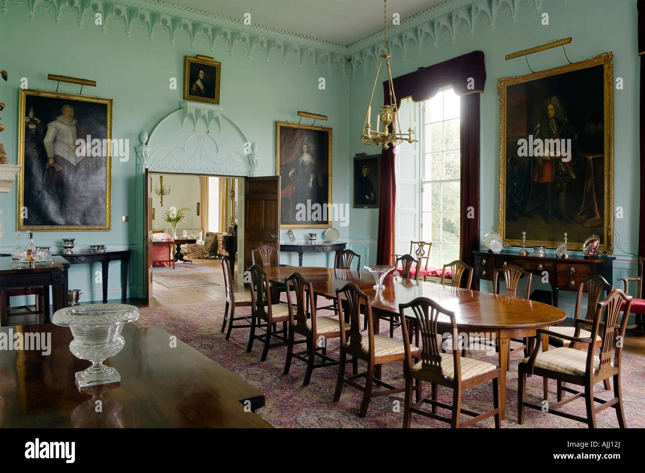 Dining Room With Oil Paintings And Double Door In 17th Century Irish Castle