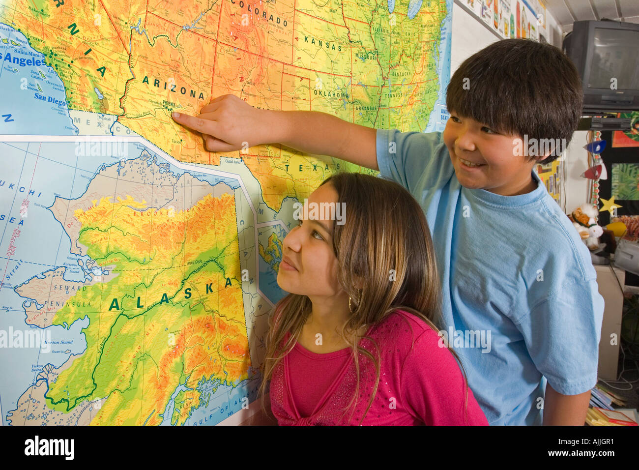 Alaskan Native Children In Classroom Reading Map Together Inside - Map reading for children