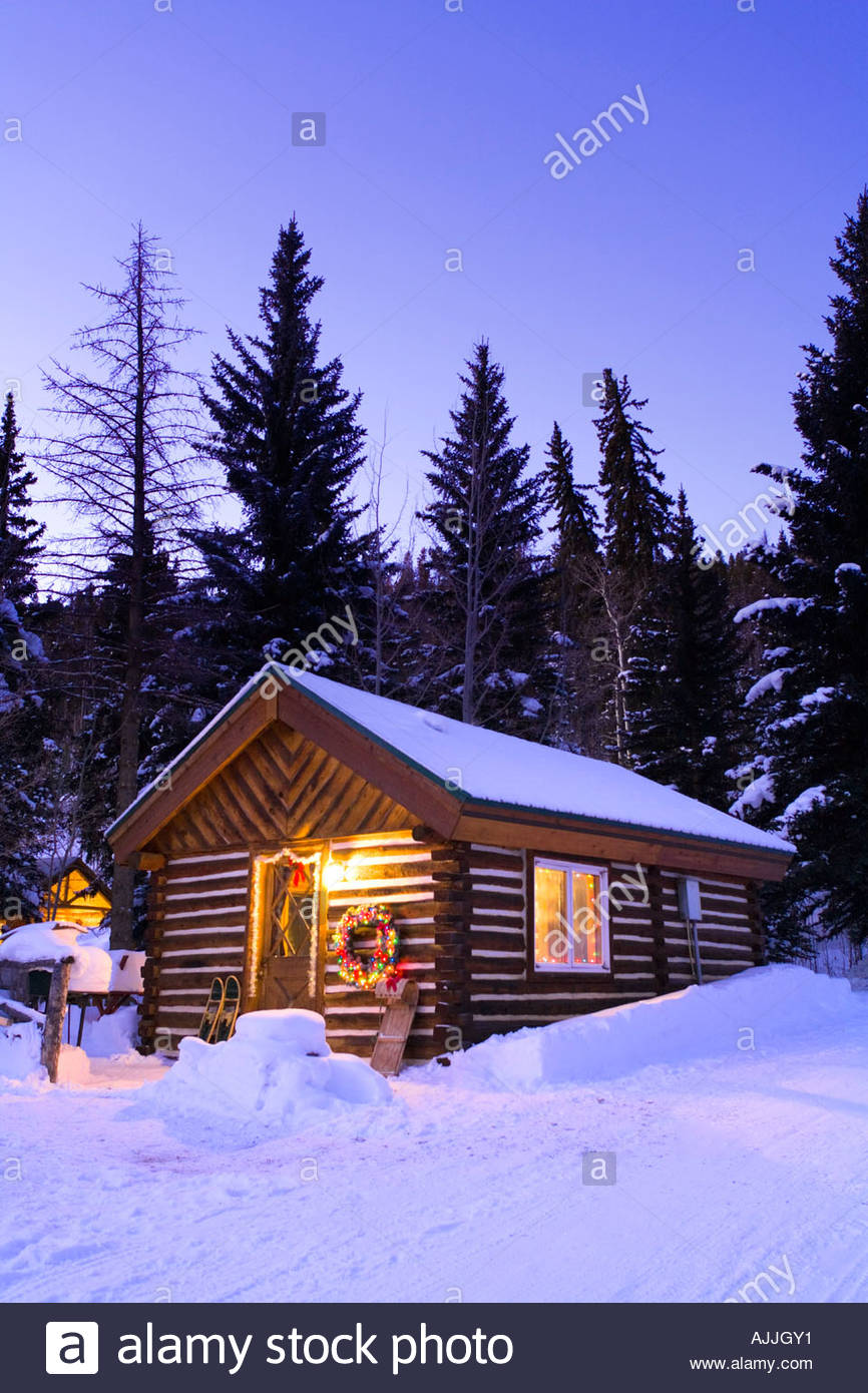 Holiday decorated cabin in snow covered forest Rocky Mountains Colorado  Winter near Granby. Holiday decorated cabin in snow covered forest Rocky Mountains