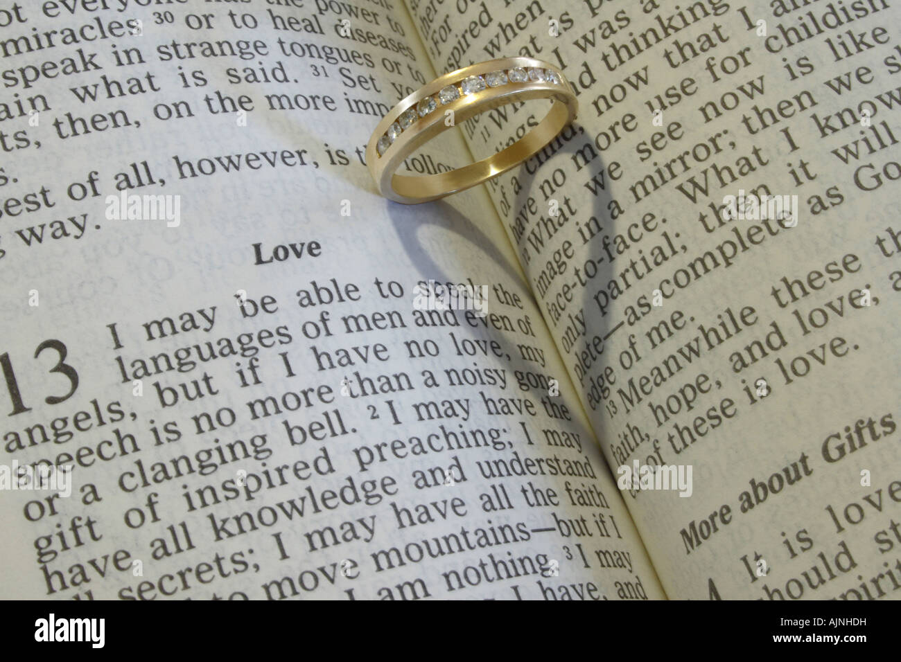 A wedding ring on an open Bible Stock Photo