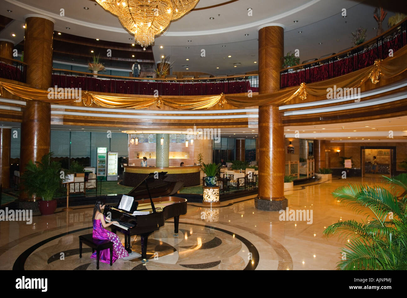 Pianist in lobby of pearl river garden hotel sanya city hainan province china asia