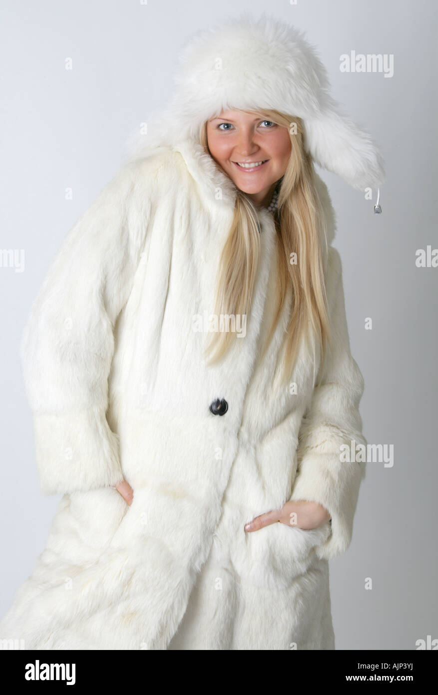 Blonde Girl In A White Fur Coat And Hat Stock Photo Royalty Free