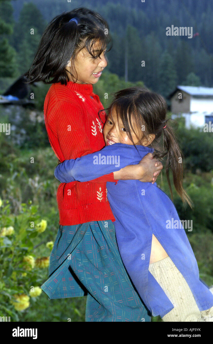 two small little indian children girls kids playing happy outdoors