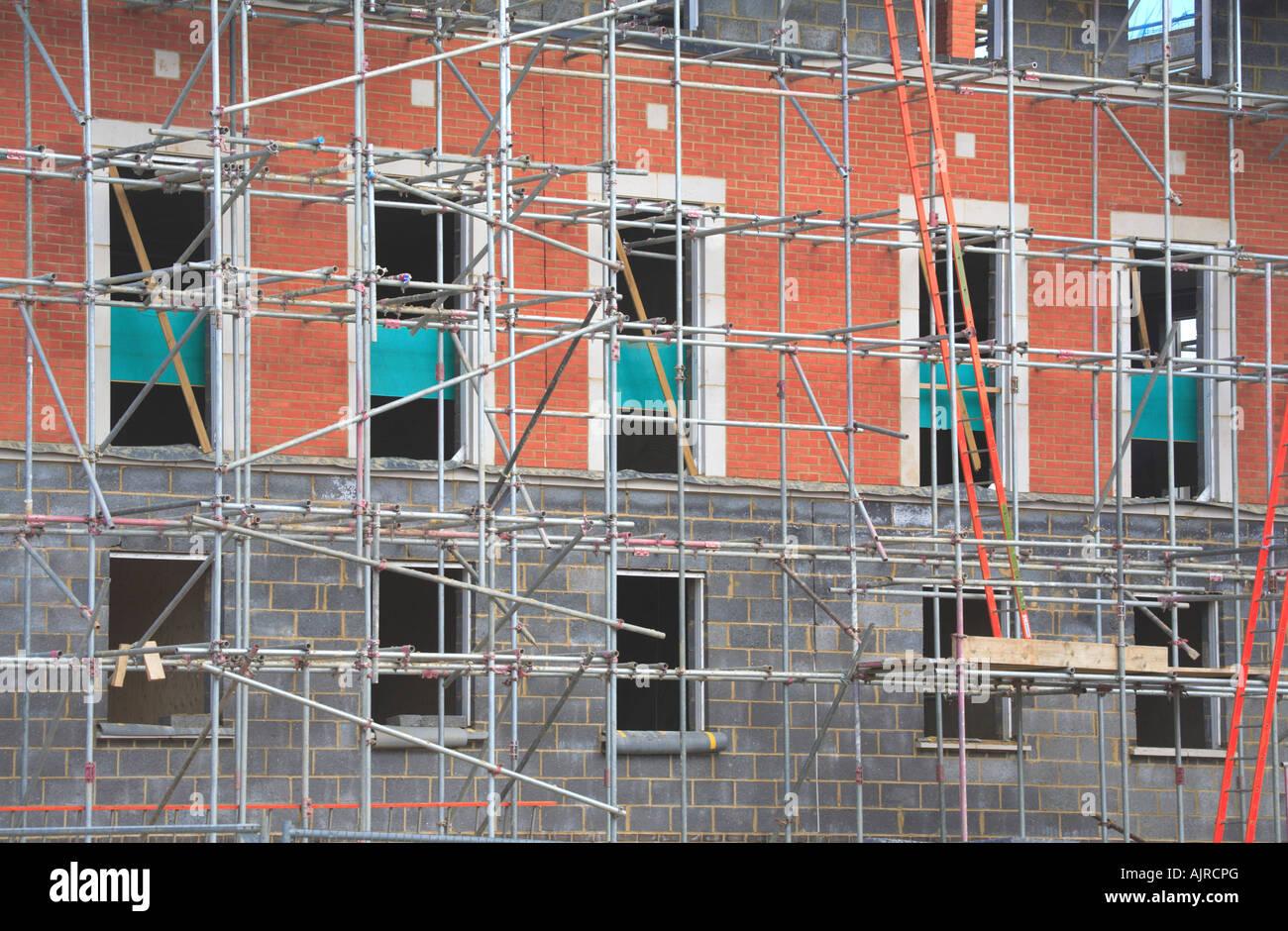 scaffold scaffolding safe ladder building build red brick security scaffold scaffolding safe ladder building build red brick security pipes poles house property
