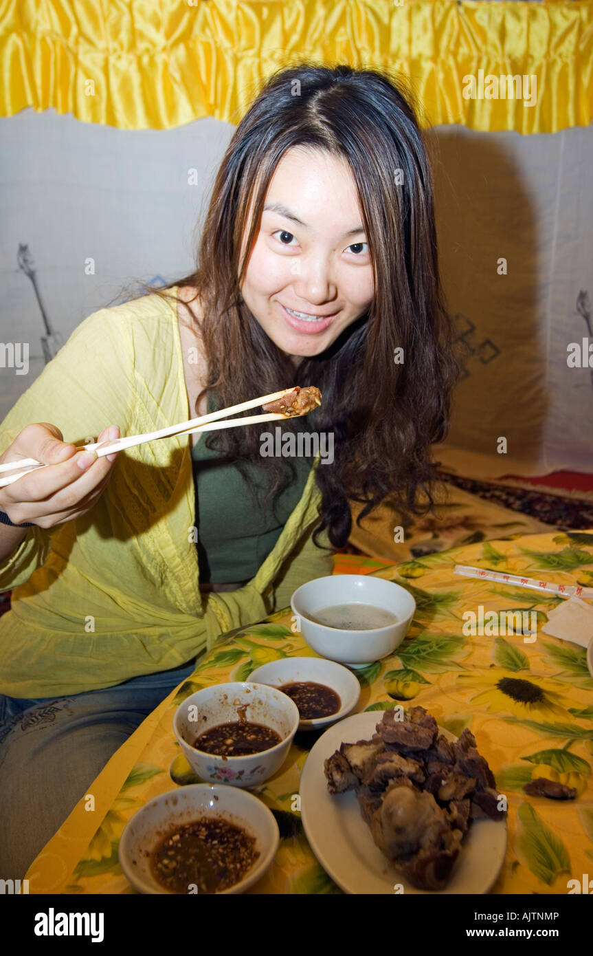 a Chinese girl eating mutton dinner inside a traditional yurt tent on Xilamuren grasslands Inner Mongolia province China MR  sc 1 st  Alamy & a Chinese girl eating mutton dinner inside a traditional yurt tent ...