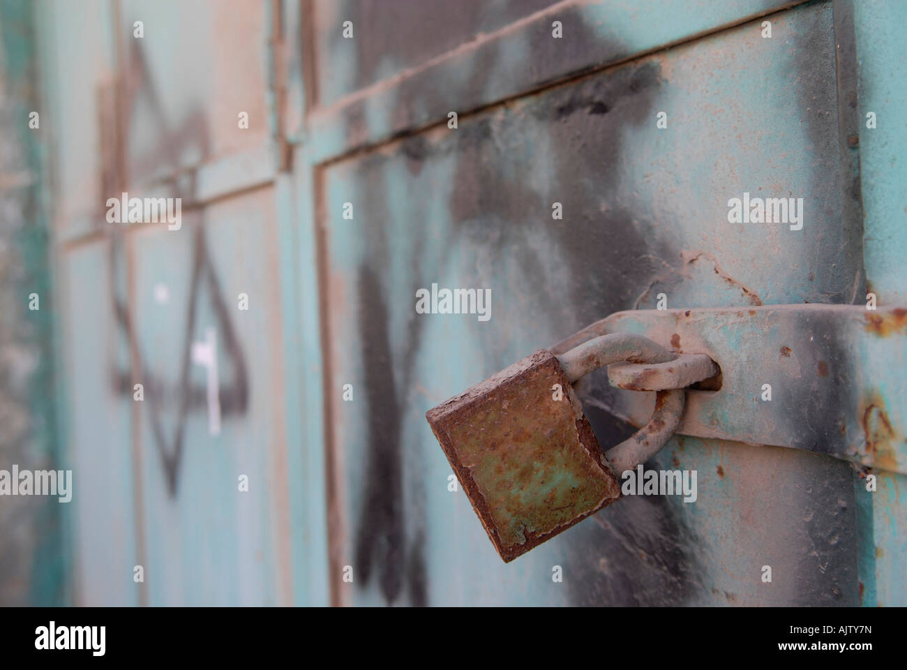 A closed palestinian shop sprayed with the jewish symbol star of a closed palestinian shop sprayed with the jewish symbol star of david at shuhada street in the kasba old city of hebron west bank israel buycottarizona Images