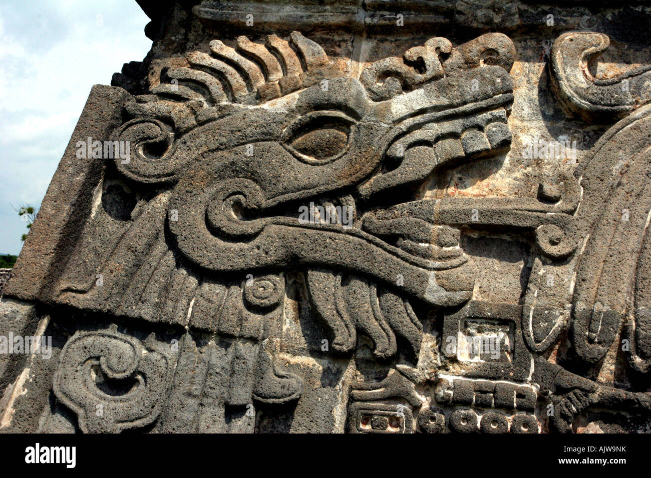 Ancient stone serpent deity carving sculpture on a mayan