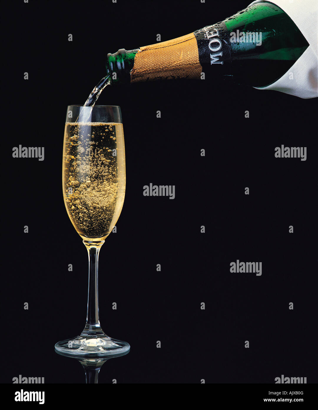 close up of moet et chandon champagne pouring from bottle into glass stock photo royalty free. Black Bedroom Furniture Sets. Home Design Ideas