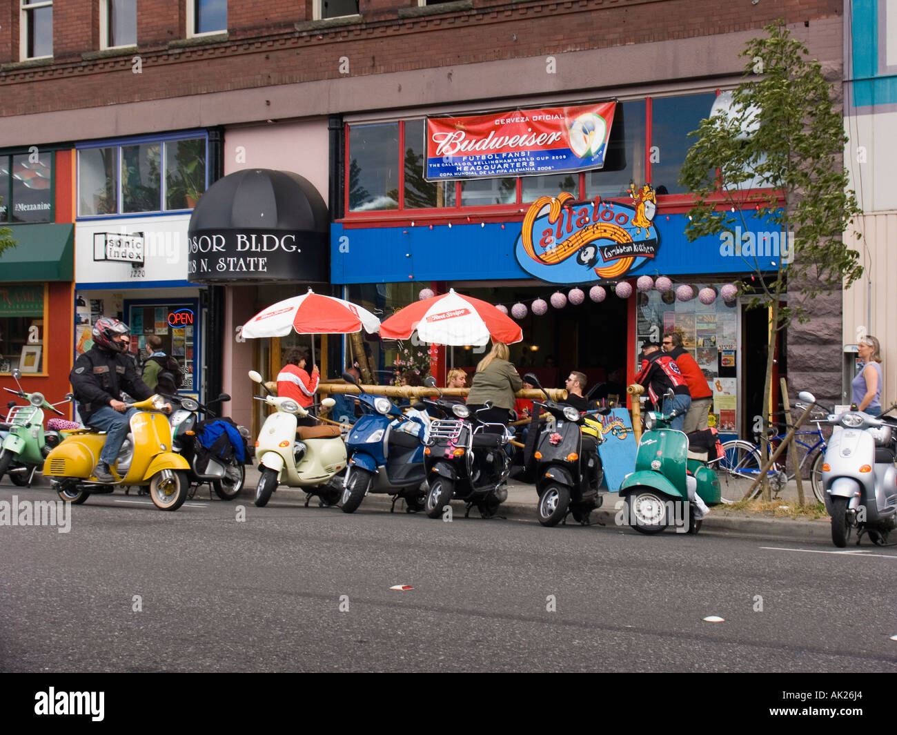gathering of scooter enthusiasts at callaloo caribbean kitchen bar