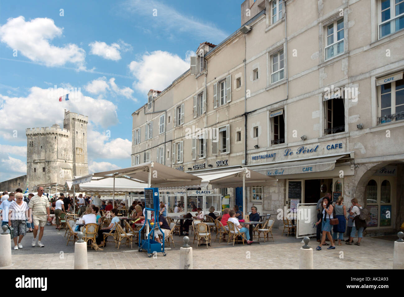 Cafe in the vieux port terra vecchia bastia corsica france stock - Pavement Cafe In The Vieux Port With The Tour St Nicolas Behind La Rochelle Poitou Charentes France