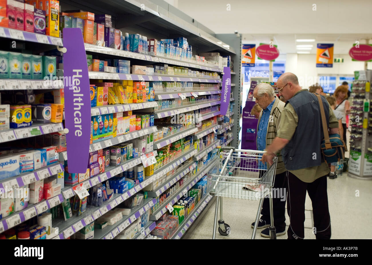 Products elderly care products elderly care products product on - An Elderly Gentleman Choosing Health Care Products In A Supermarket Assisted By A Younger Man