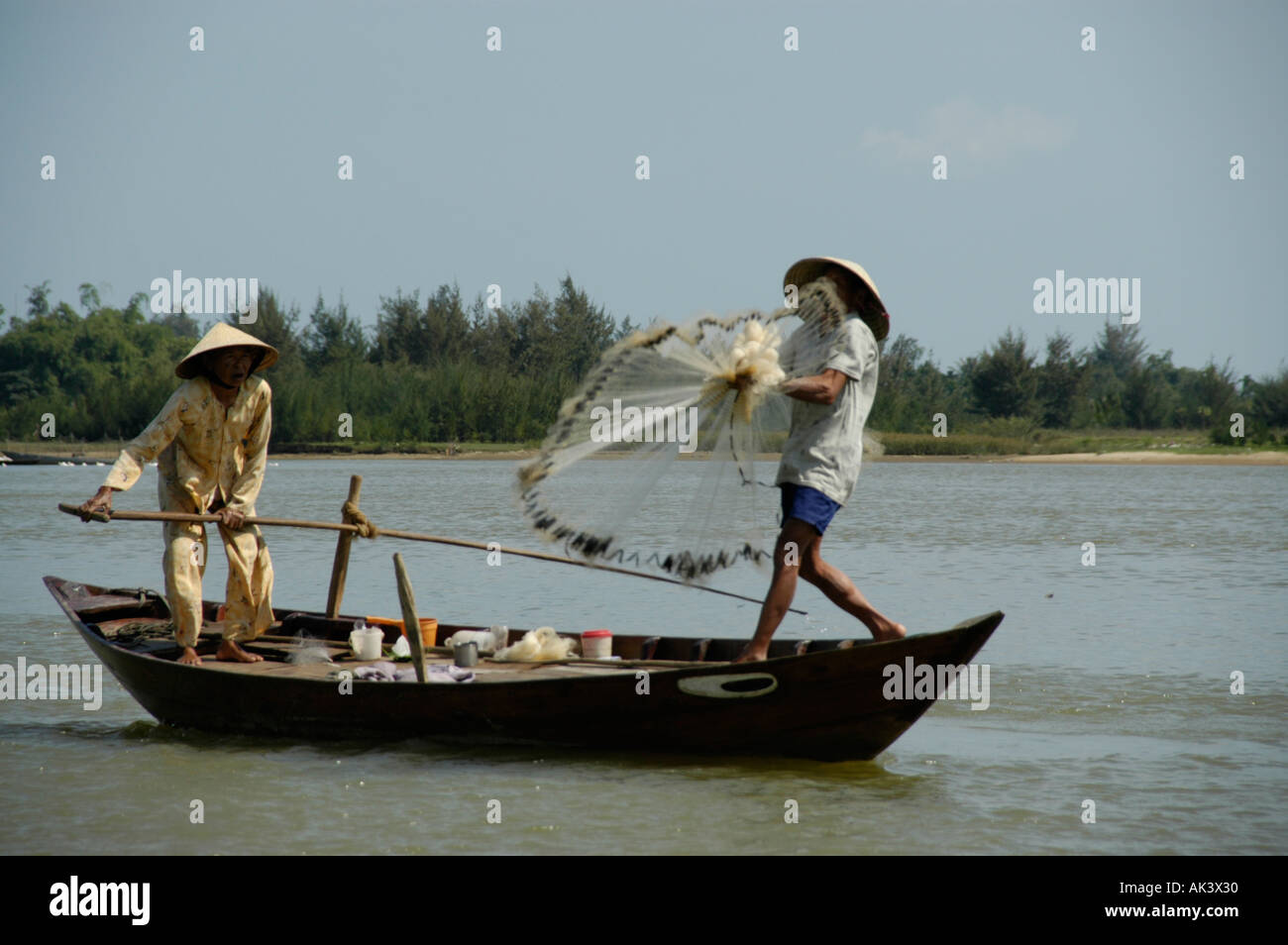 Fisherman with net and boat