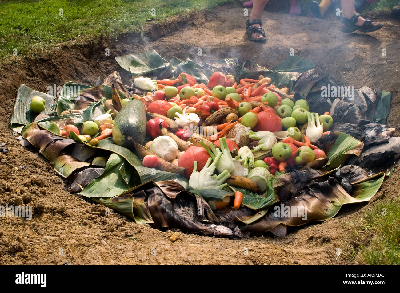 Curanto Cooking In The Earth Oven Vegetables Cooking Over