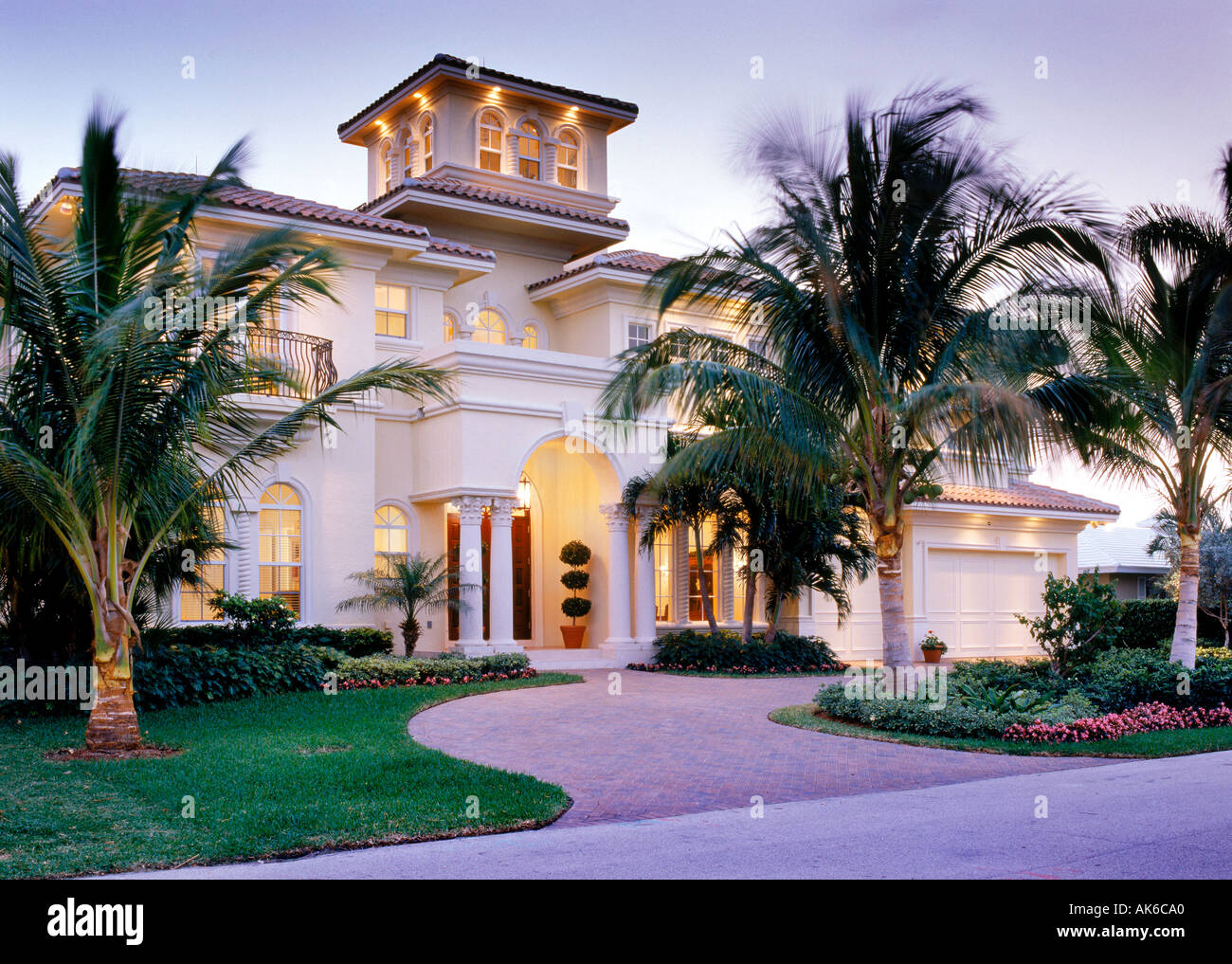 Mediterranean style home exterior at dusk stock photo for Mediterranean style modular homes