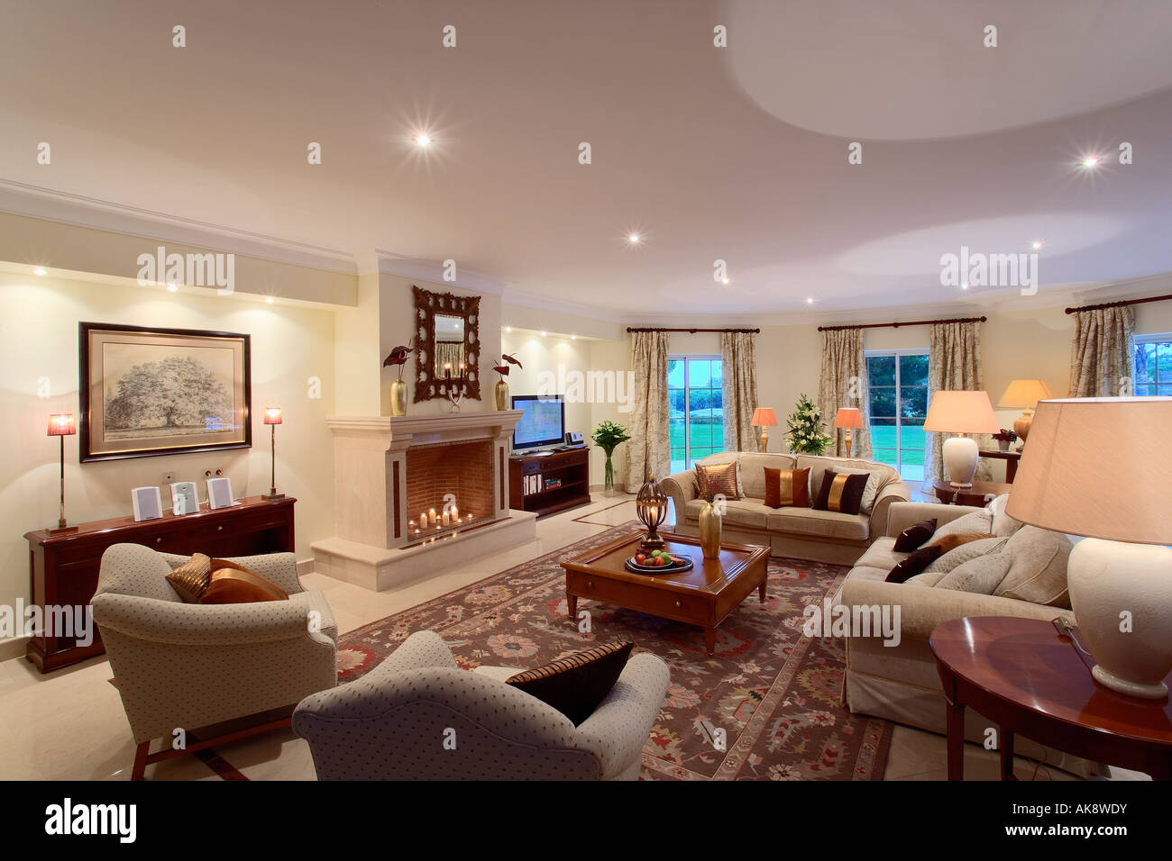 Beige Armchairs And Sofas In Portuguese Living Room With Downlighting