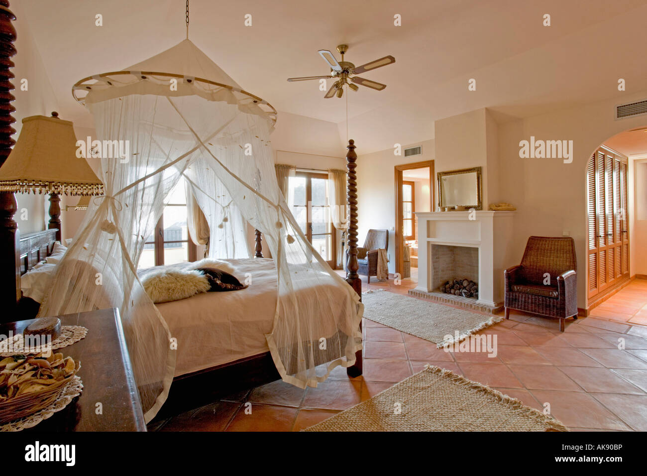 Mosquito Net Above Bed In Modern Spanish Bedroom With Traditional Furniture