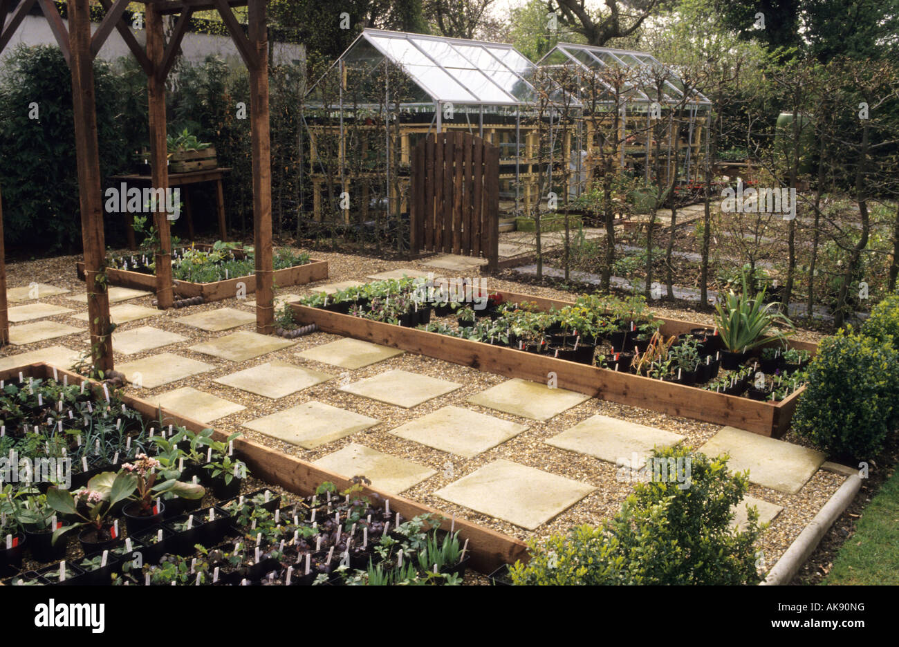 Stock photo the anchorage kent tidy organized garden work area including small glasshouse