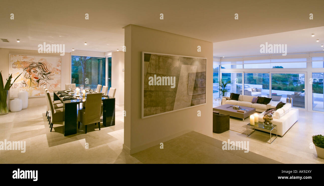 Downlighting in modern Spanish dining room at night with patio