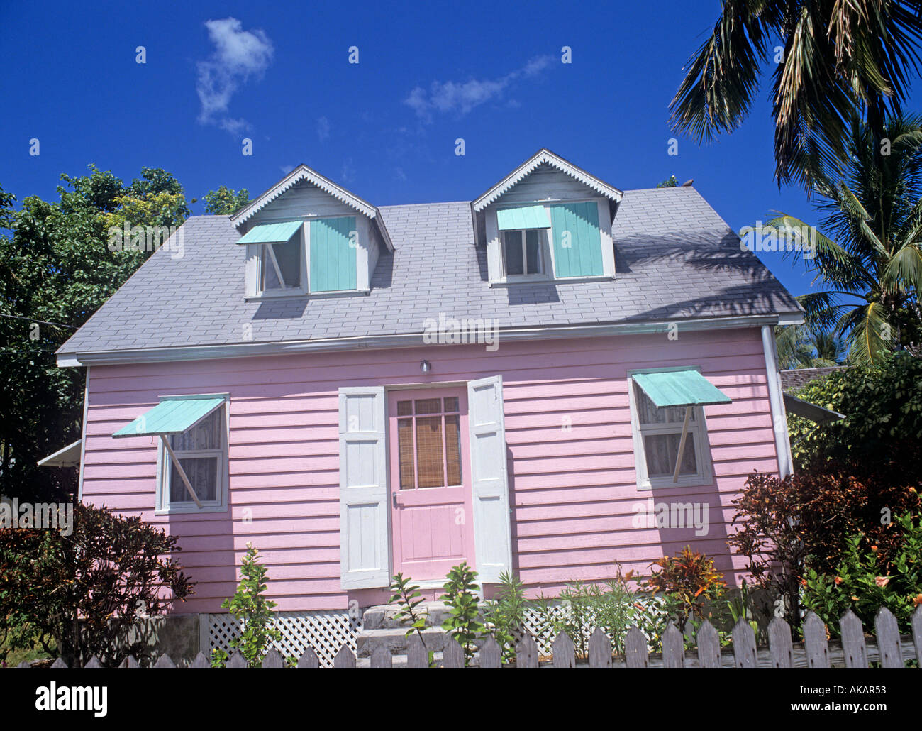 Traditional Tropical Wooden Building Painted In Pastel