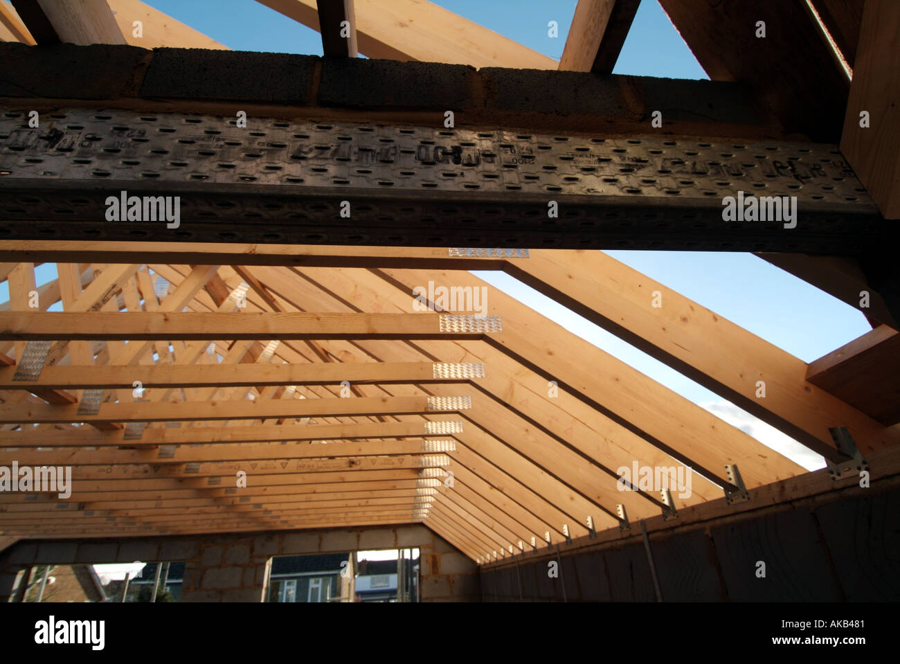 Detached house under construction showing roof truss for Prefab roof rafters