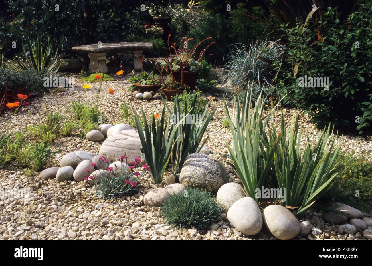 Heathfield Surrey Gravel Garden With Stones Pebbles Phormium Stone Seat