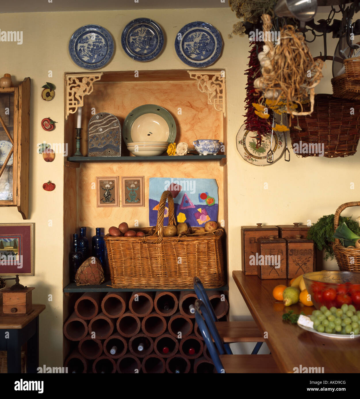 Kitchen Alcove Large Basket And Terracotta Wine Storage In Kitchen Alcove Stock