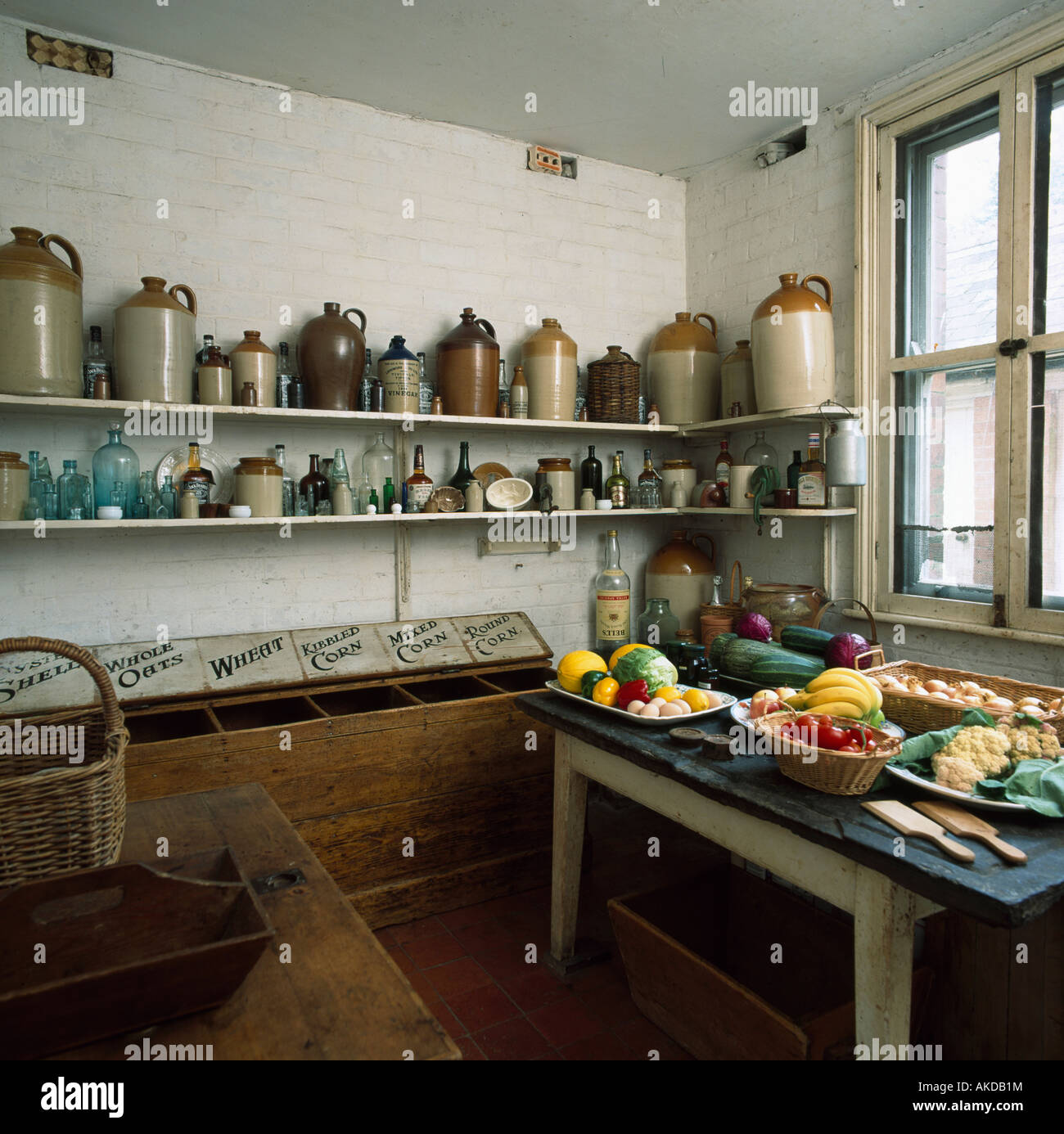 Earthenware jars on shelves in old fashioned larder with for Traditional kitchen shelves