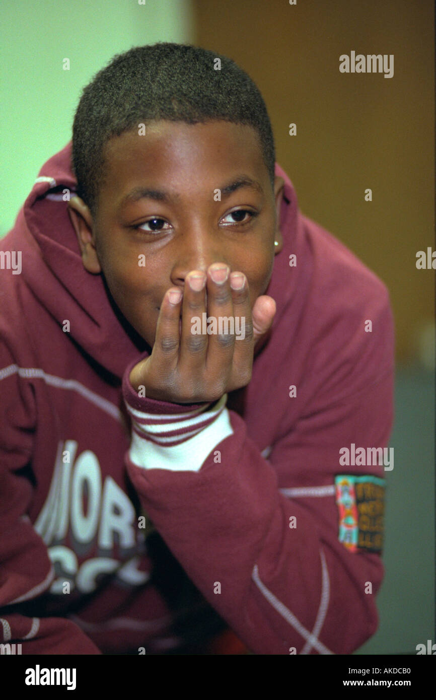 black teen Black teen age 14 happily thinking with hand on chin at youth center. St  Paul Minnesota USA