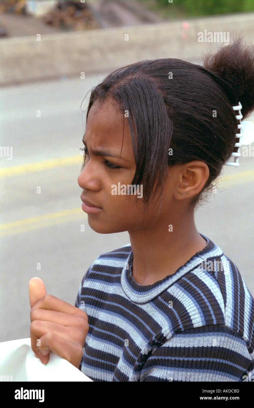 black teen Black teen Girl age 14 looking into the distance worried at Cinco de Mayo  Festival. St Paul Minnesota USA