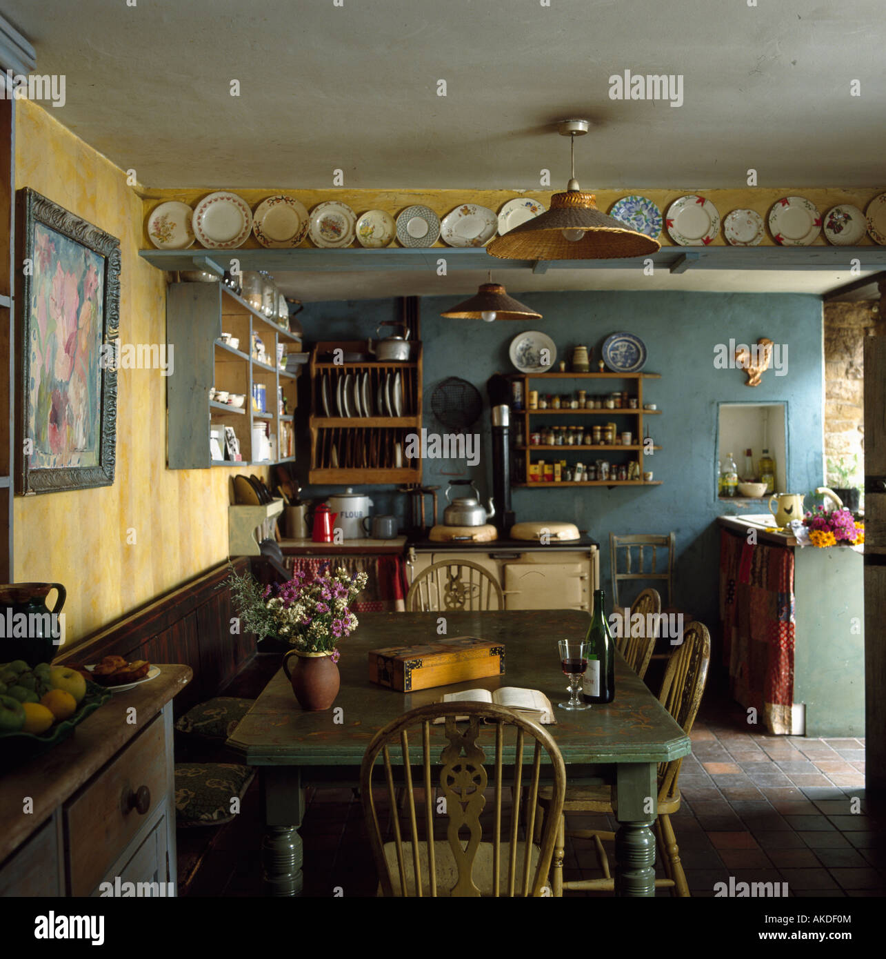 Windsor Chairs In Small Blue And Yellow Cottage Kitchen