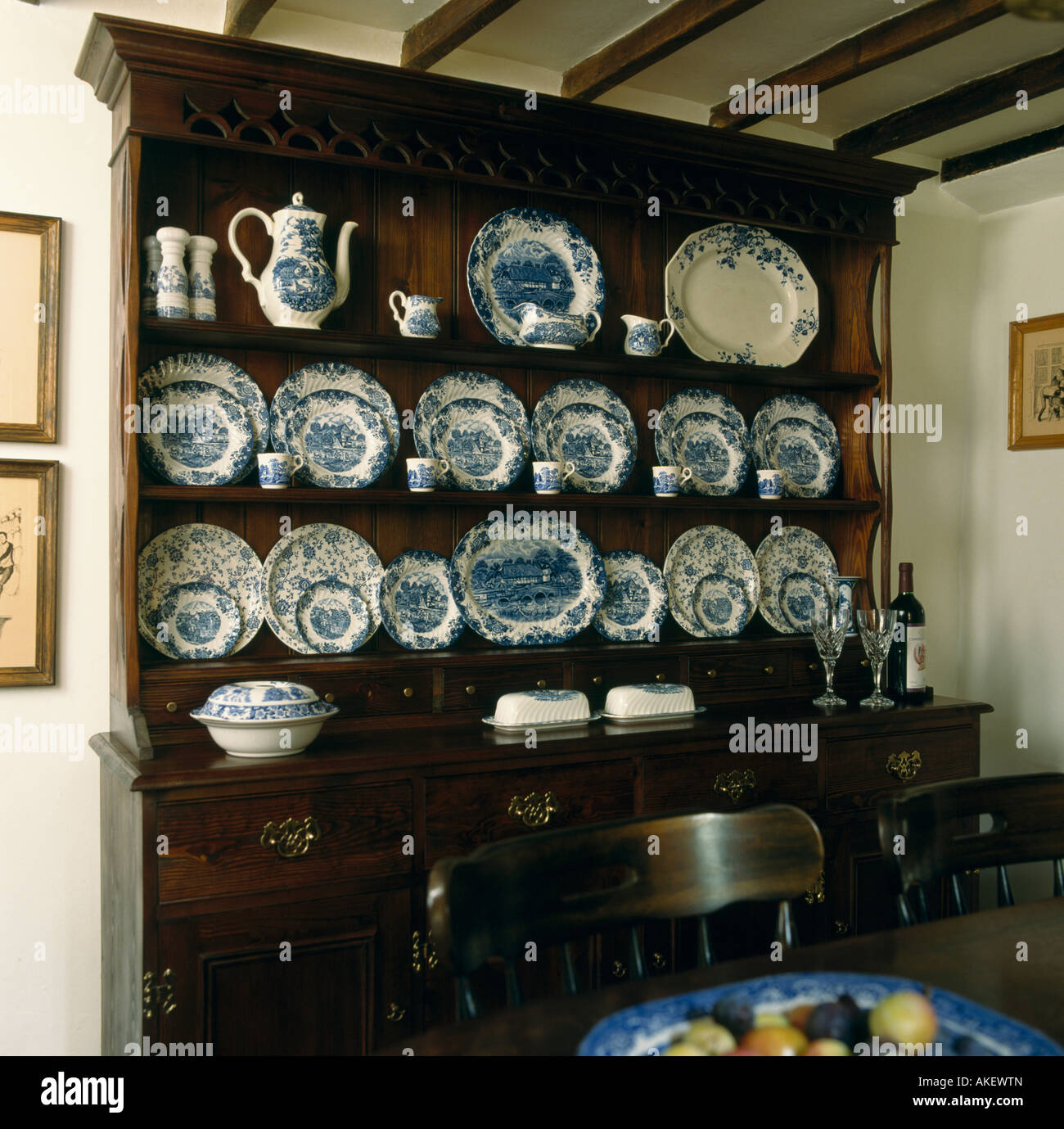 Blue And White China On Oak Dresser In Cottage Dining Room
