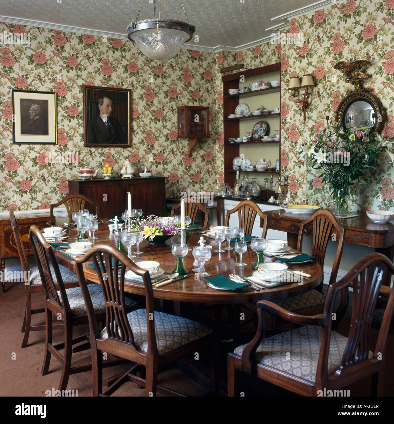 Floral Wallpaper In Formal Dining Room With Place Settings On The Table