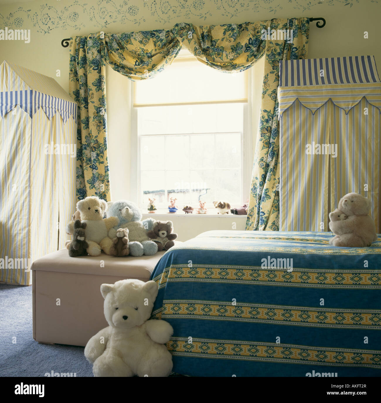 Blue Yellow Floral Curtains And Striped Bed Linen In Childs Bedroom With Teddy Bears