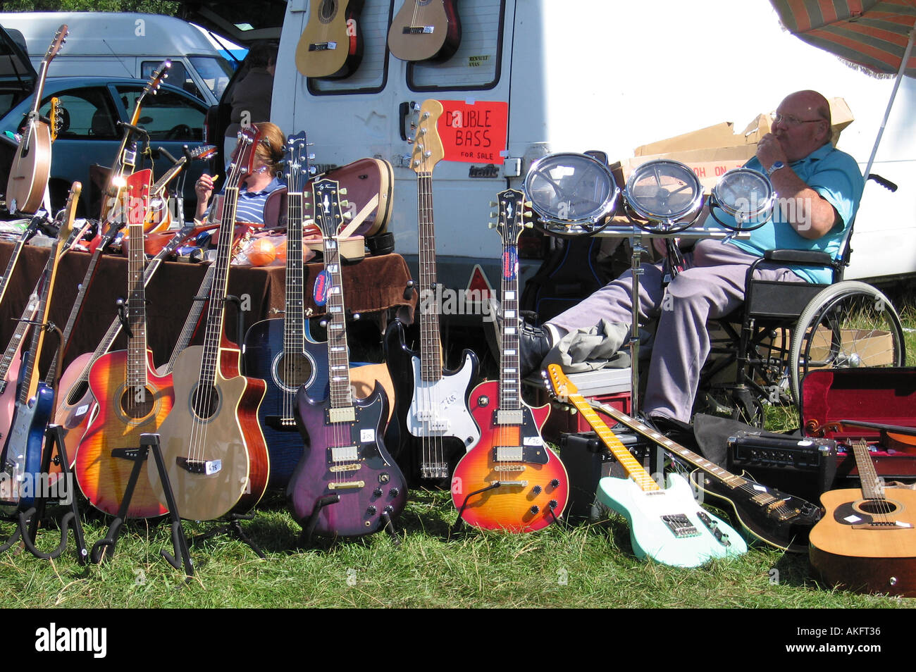 man in wheelchair selling musical instruments at tatton park classic stock photo royalty free. Black Bedroom Furniture Sets. Home Design Ideas