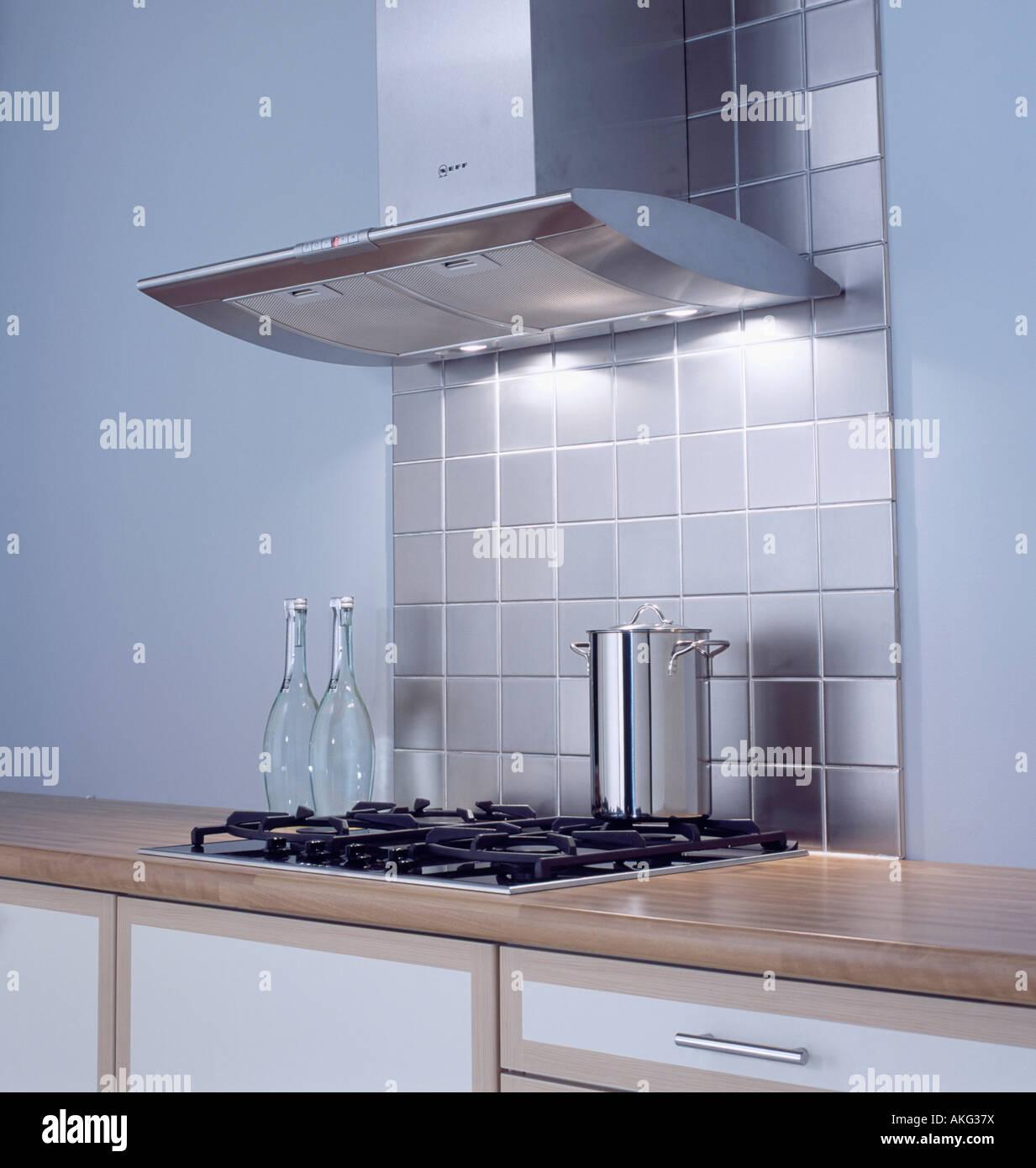 Stainless steel tiles below extractor fan above hob in modern kitchen stock photo royalty free - Modern kitchen below ...