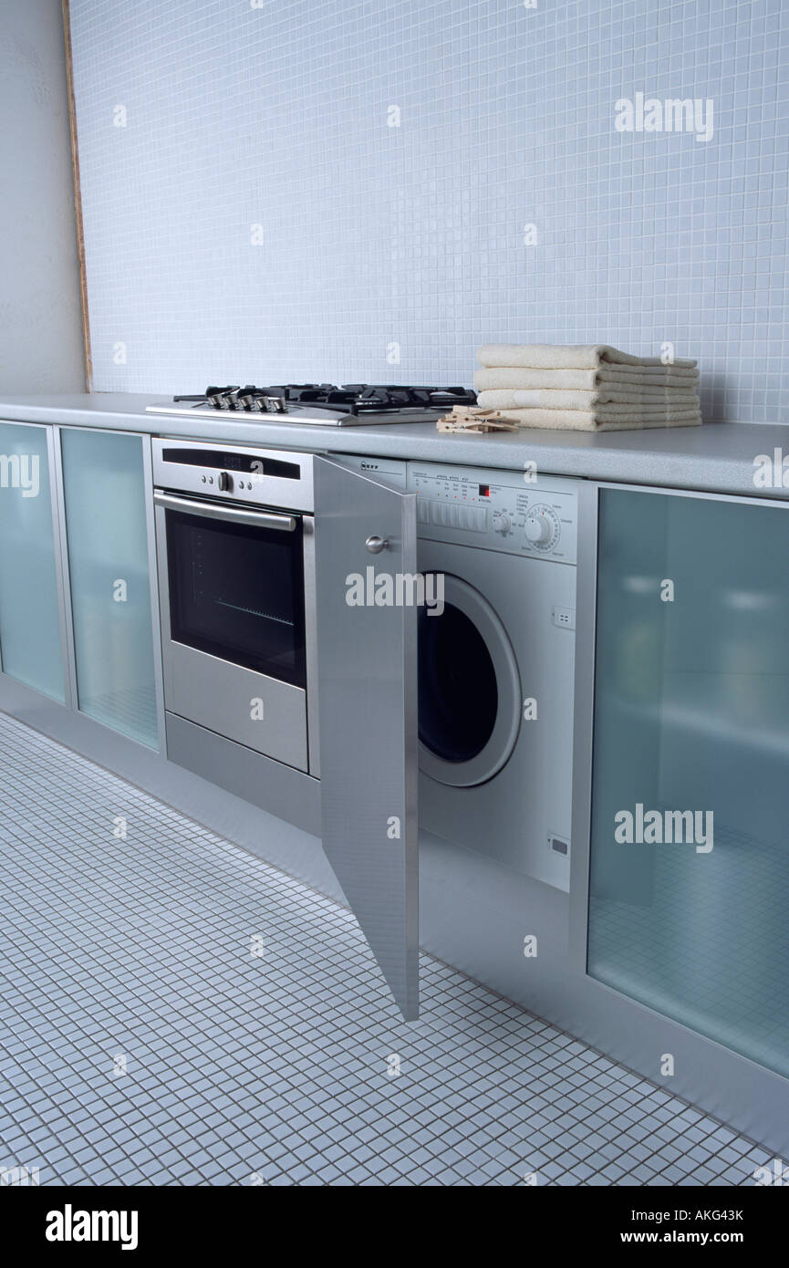 close up of oven and built in washing machine in modern. Black Bedroom Furniture Sets. Home Design Ideas