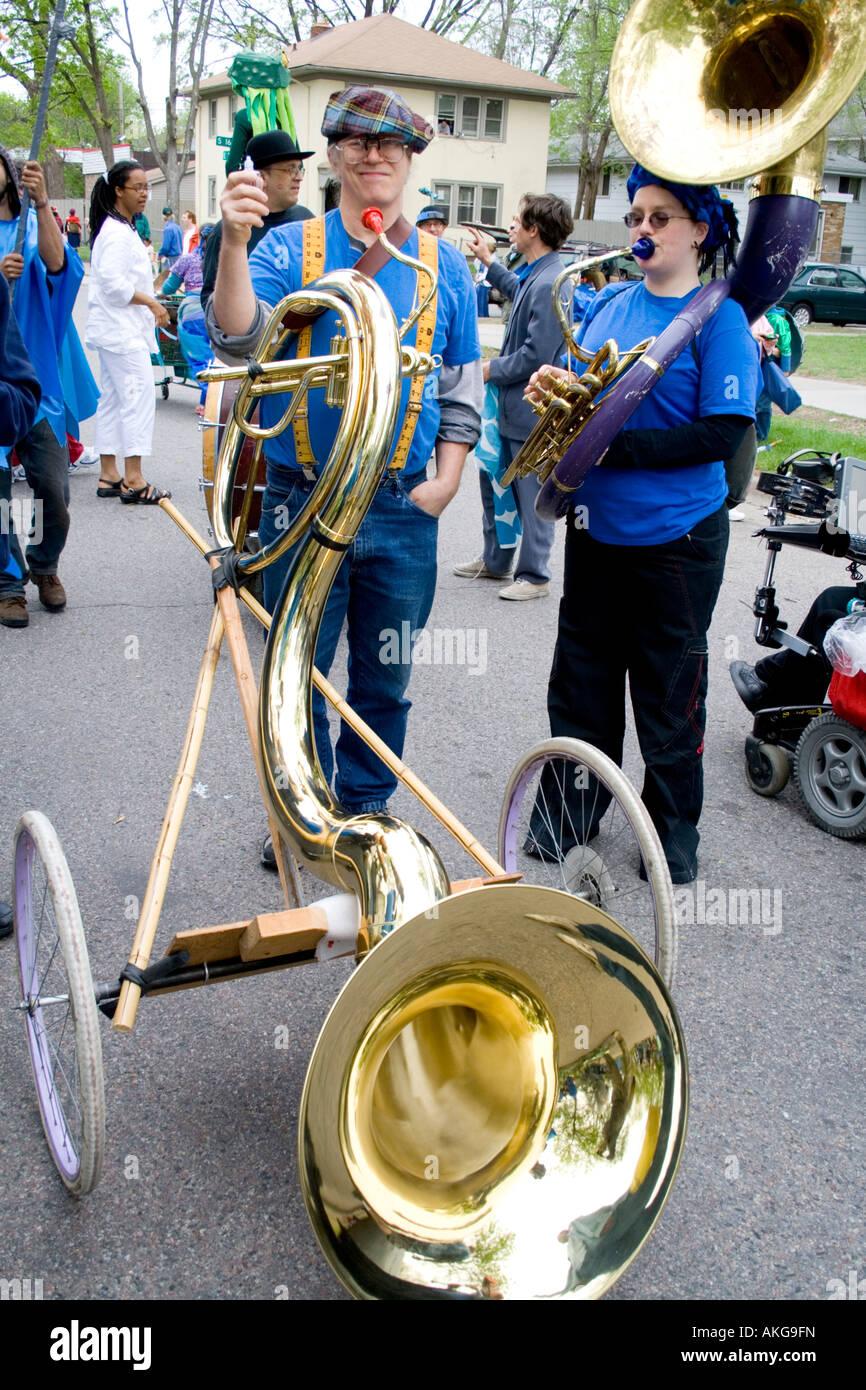 Band Members Holding Mobile Sousaphone Tuba On Wheels
