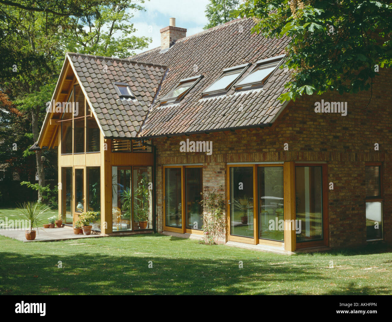 Stock photo velux windows and sliding glass doors on modern country house with reclaimed pantiles