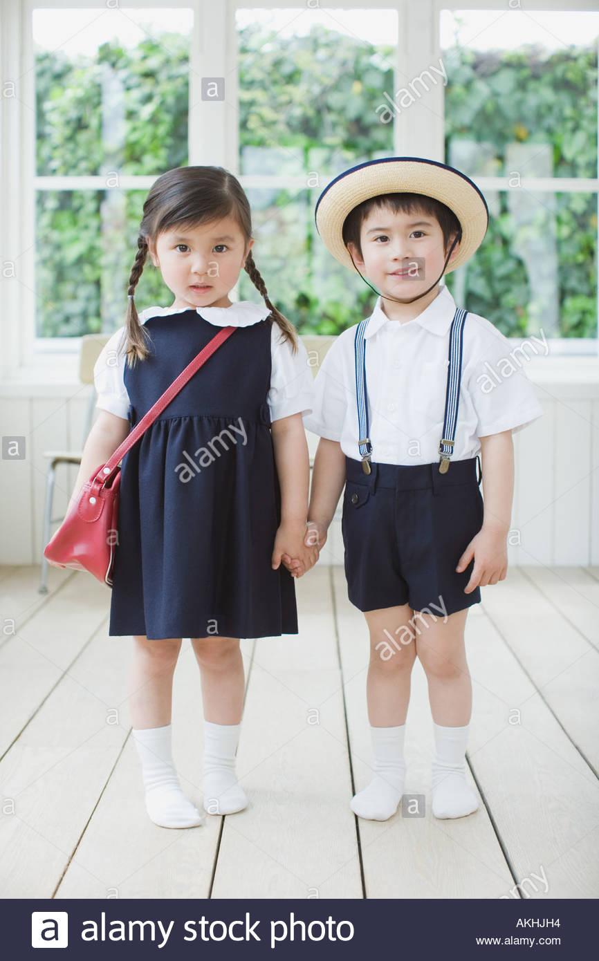 Two children wearing school uniform Stock Photo, Royalty ...