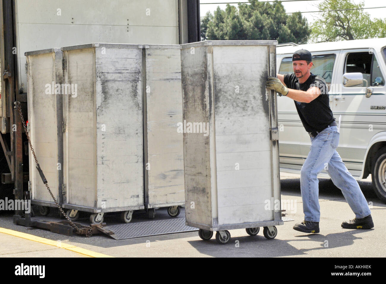 Truck Driver Man Handling Metal Containers On A Delivery To A ...