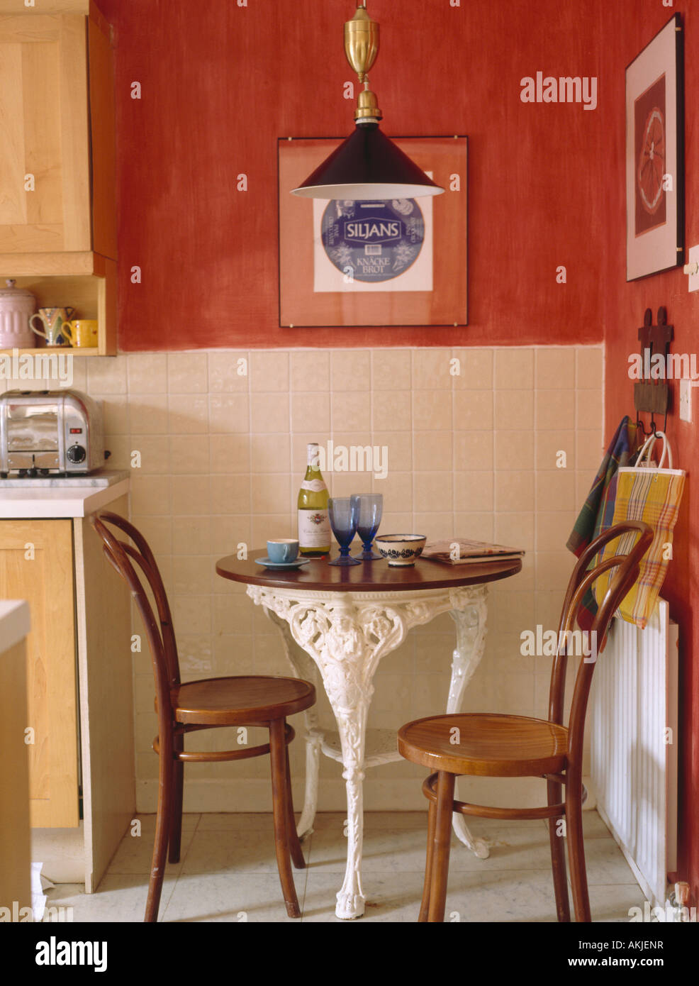 Bentwood chairs and table - Thonet Bentwood Chairs And Old French Cafe Table In Dining Corner Of Red Kitchen With White