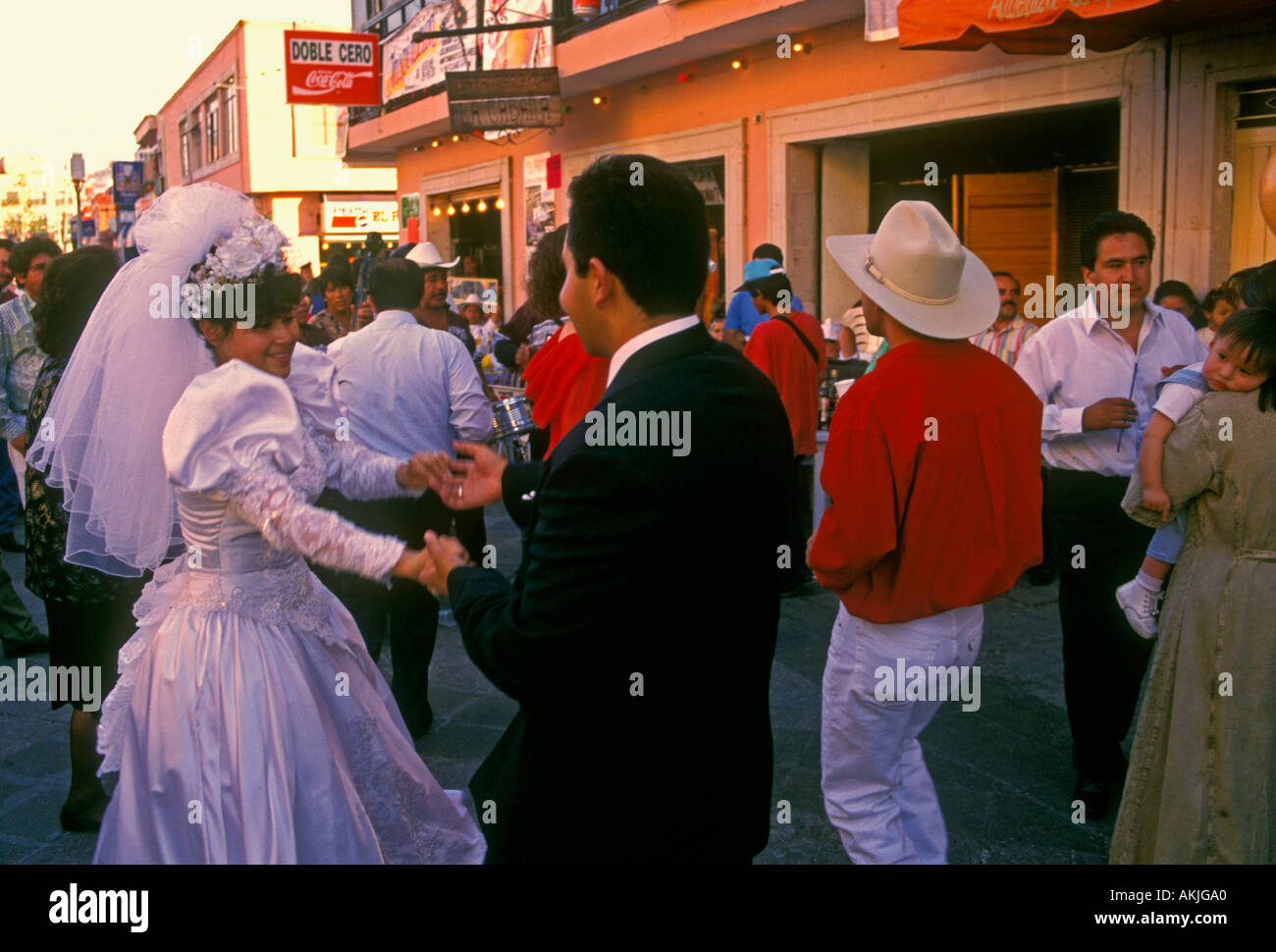 Mexican People Bride And Groom Wedding Guests Party Dancing Along Street In The City Of